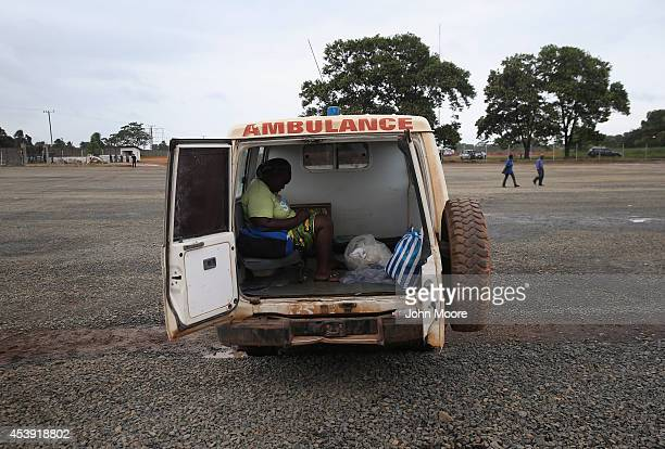 A woman sits dead in an ambulance after dying on the way to the Doctors Without Borders Ebola treatment center on August 21 2014 near Monrovia...