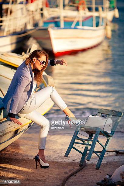 Woman sits in a fishing boat