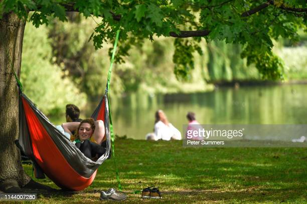 A woman sits in a hammock while relaxing in hot weather in St James's Park on May 15 2019 in London England Forecasters are predicting days of hot...