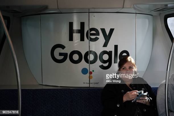 A woman sits in a Las Vegas Monorail car with a Google ad prior to the CES 2018 on January 7 2018 in Las Vegas Nevada CES the world's largest annual...