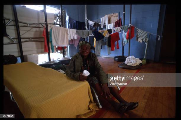 A woman sits in a shelter September 27 1989 in South Carolina Hugo is ranked as the eleventh most intense hurricane to strike the US this century and...