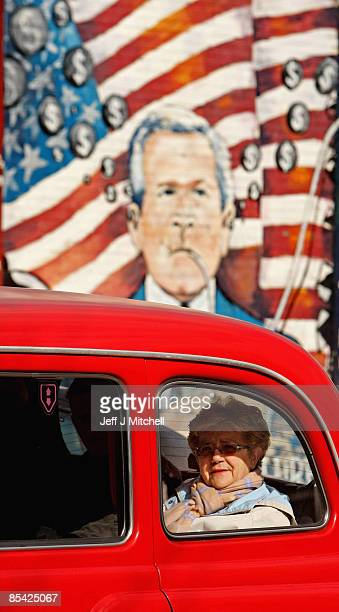 A woman sits in a taxi on the Falls road area on March 14 2009 in Belfast Northern Ireland Communities in Northern Ireland remain adamant that they...