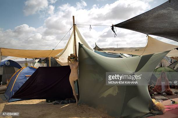 A woman sits in a tent during the 2015 Midburn festival in the Negev Desert near the Israeli kibbutz of Sde Boker on May 22 2015 Some 6000 Israelis...