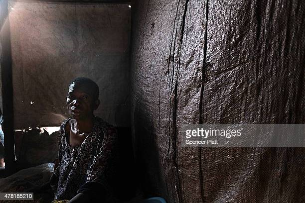 Woman sits in a tent in a refugee camp for people displaced in conflicts and turmoil that has afflicted Burundi over the last 25 years on June 23,...
