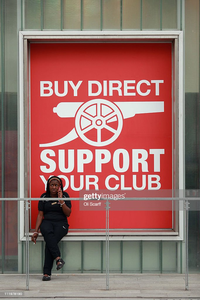A woman sits in front of the club shop at Arsenal Football Club's Emirates Stadium on April 11, 2011 in London, England. American businessman Stan Kroenke's company 'Kroenke Sports Enterprises' has increased its shareholding in Arsenal to 62.89% and will make an offer for a full takeover of the club. Mr Kronke first purchased 9.9% of Arsenal shares in 2007, today's deal values the Premier League club at 731m GBP.