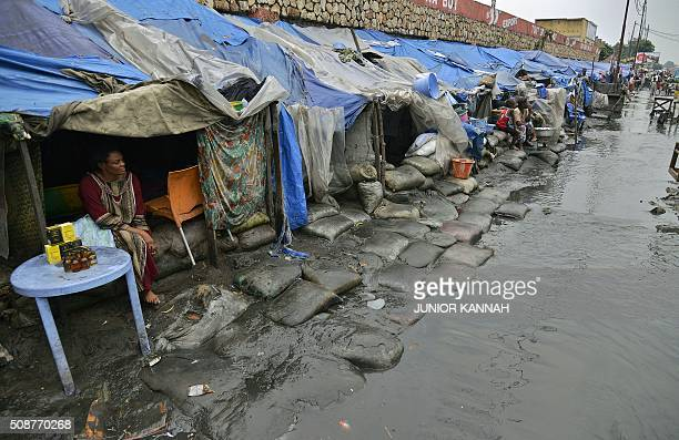 Woman sits in her flooded makeshift home in Kinshasa on February 5, 2016. For the last seven months 167 DR Congo families have lived in the...