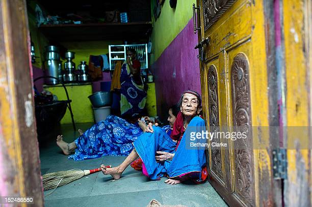 A woman sits in the doorway of her home in Dharavi November 4 2011 in Mumbai India Dharavi Asia's largest slum situated in the centre of Mumbai One...