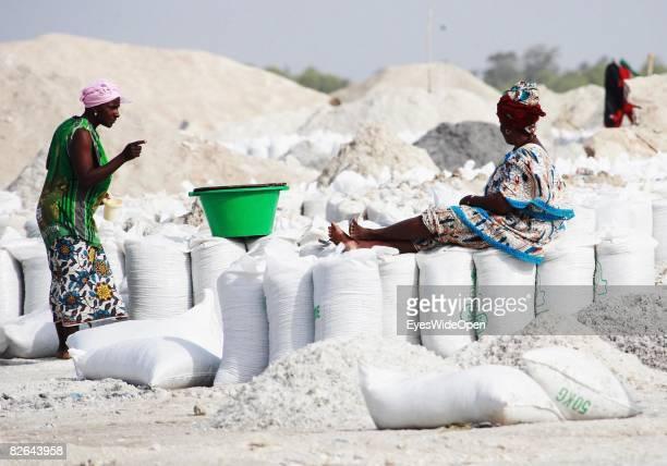 Woman sits on a bag of salt on rhe beach of Retba-Lake where locals extract salt on December 27, 2007 near Dakar, Republic of Senegal. Dakar is the...
