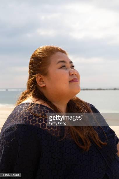 a woman sits on a beach on the philippines - filipino ethnicity and female not male fotografías e imágenes de stock