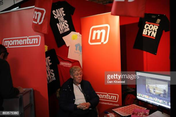 A woman sits on a Momentum stand on day two of the Labour Party Conference on September 25 2017 in Brighton England