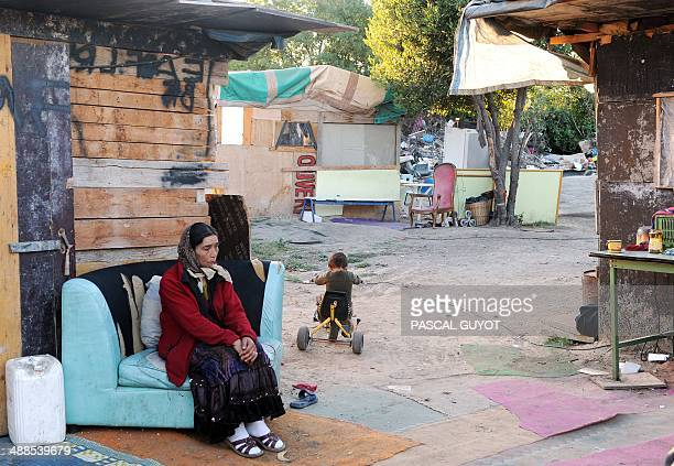 A woman sits on August 19 2010 in a camp of people belonging to Roma community which could be evacuated in the Port Marianne area of Montpellier...