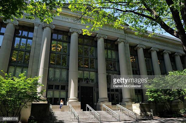 A woman sits outside Harvard Law School's Langdell Hall May 10 2010 at Harvard University in Cambridge Massachusetts US President Barack Obama...