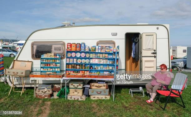 Woman sits outside her caravan selling vintage boxes and packaging during the final day of the Whitby Traction Engine Rally on August 5, 2018 in...