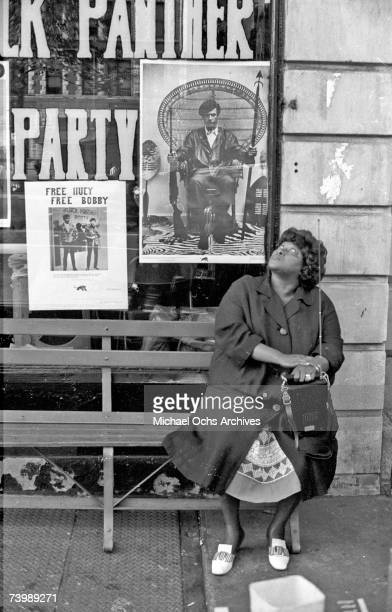 A woman sits outside the Harlem Black Panther HQ circa 1968 in New York City New York