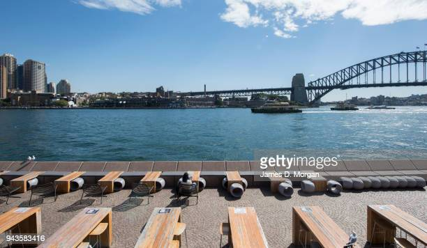 A woman sits with a few seagulls beside the harbour on April 9 2018 in Sydney Australia Sydney has been experiencing unseasonably high temperatures...