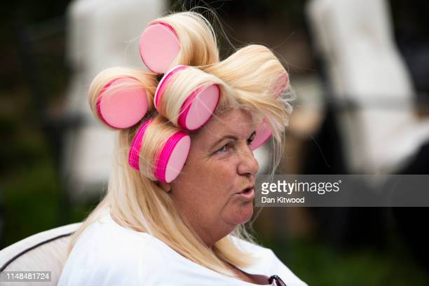 Woman sits with curlers in her hair during the annual Appleby Horse Fair on June 07, 2019 in Appleby-in-Westmorland, England. The annual gathering...