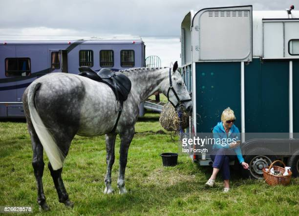 Woman sits with her horse during the Osmotherley Country Show on August 5, 2017 in Osmotherley, England. The annual show hosts pony, cattle and sheep...