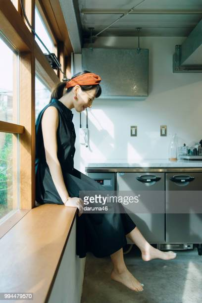 woman sitting a window. - hot female models stock pictures, royalty-free photos & images