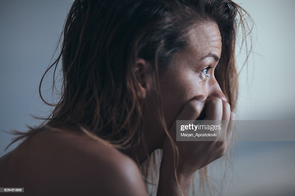 Woman sitting alone and depressed : Stock Photo
