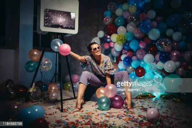 woman sitting alone on new year's party - after party stock pictures, royalty-free photos & images