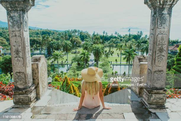 woman sitting at abandoned structure - bali stock pictures, royalty-free photos & images