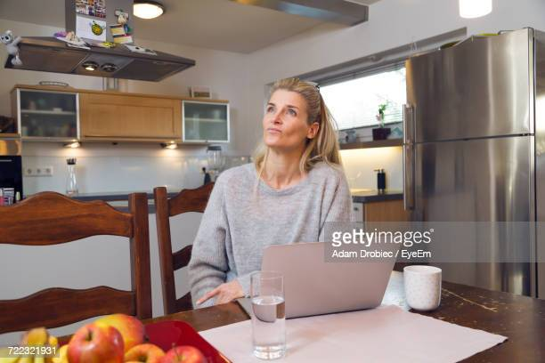 Woman Sitting At Home