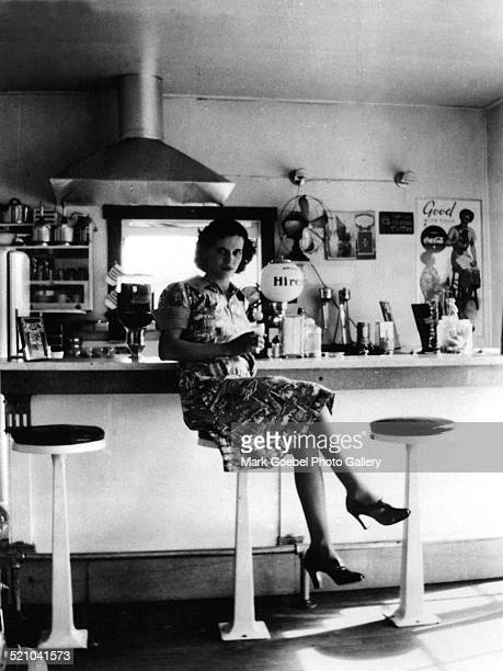 Woman sitting at lunch counter late 1930s