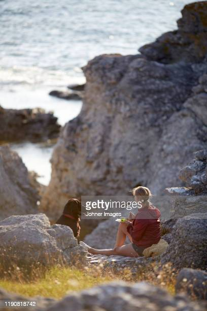 woman sitting at sea - gotland stock pictures, royalty-free photos & images