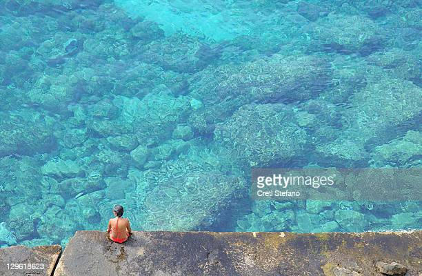 Woman sitting at seaside