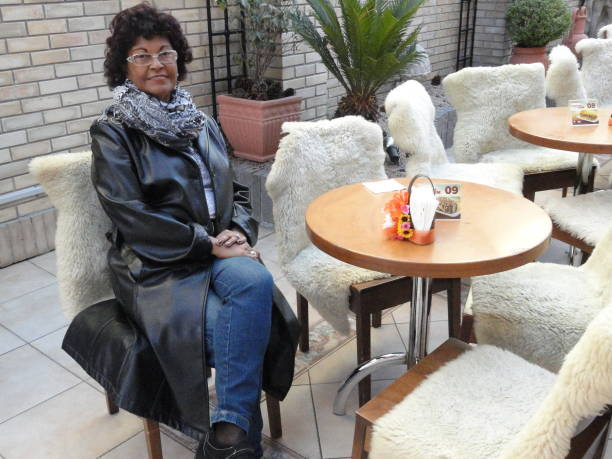 Woman Sitting At Table In Restaurant During Winter