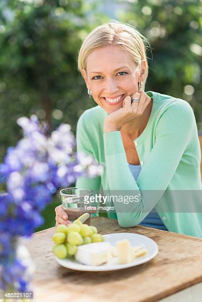 Woman sitting at table outdoors