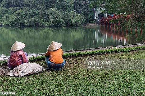 Woman sitting at the Sword Lake. Vietnam