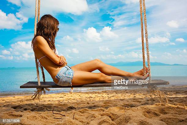 woman sitting at tropical swing - vladgans or gansovsky stock pictures, royalty-free photos & images