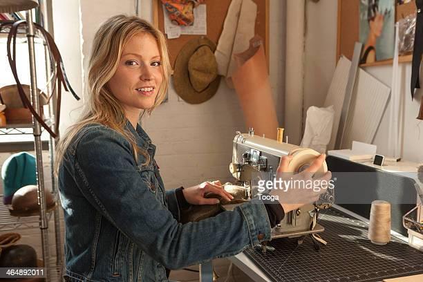 Woman sitting at vintage sewing machine