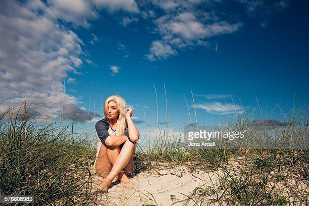 Woman Sitting Beach