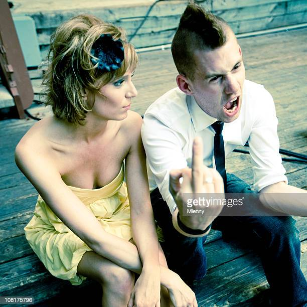 Woman Sitting Beside Young Man Giving Middle Finger