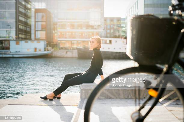 woman sitting by river - scandinavia stock pictures, royalty-free photos & images