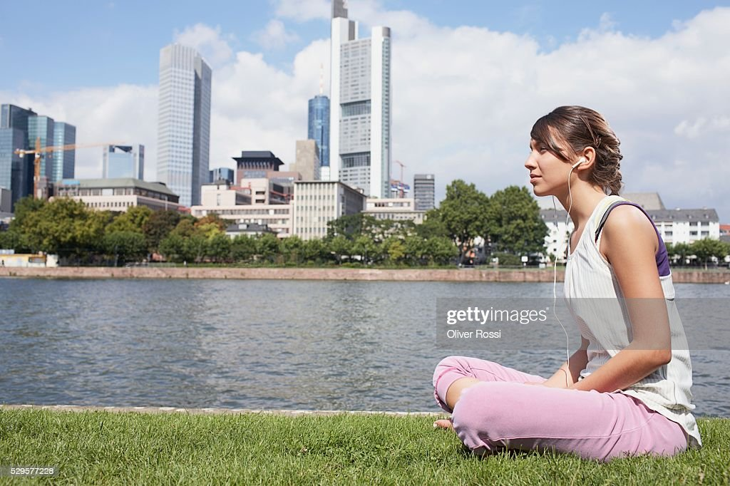 Woman Sitting by Riverbank : Bildbanksbilder