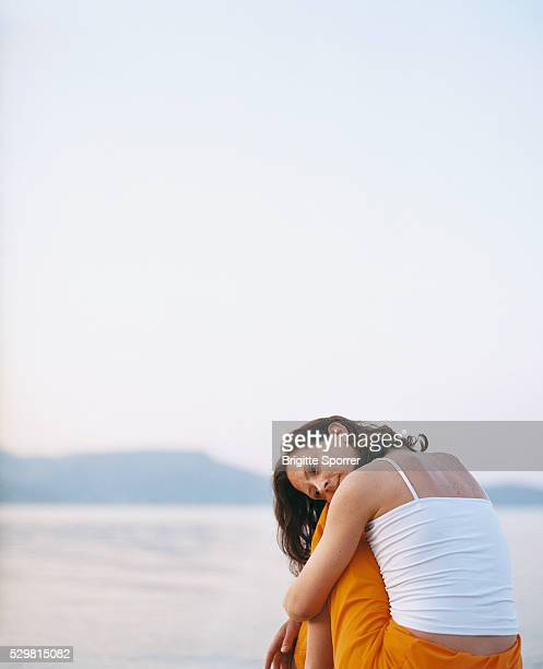 Woman Sitting by the Sea