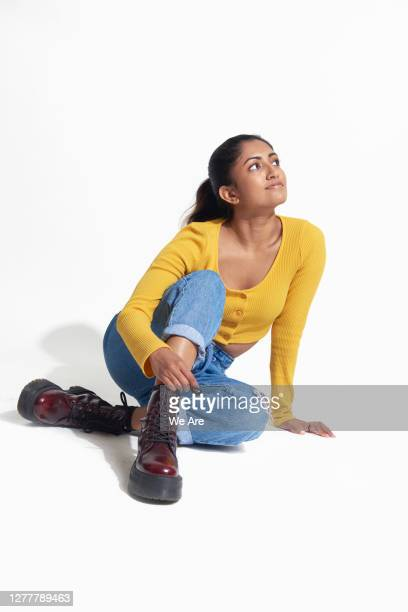woman sitting casually, looking up - contemplation stock pictures, royalty-free photos & images