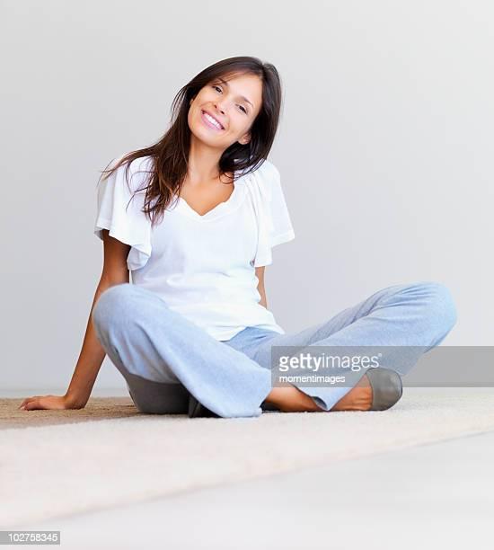 Woman sitting cross legged on floor