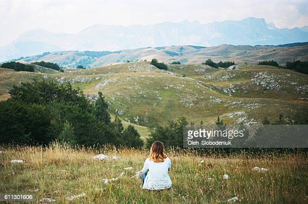 Woman sitting Durmitor National Park