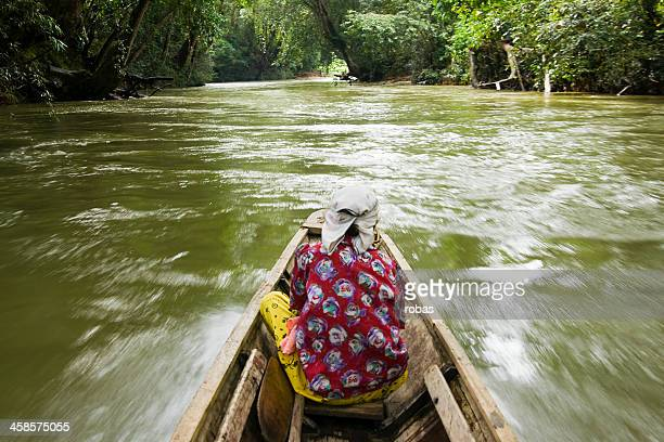 woman sitting in a boat on sarawak river - sarawak state stock pictures, royalty-free photos & images