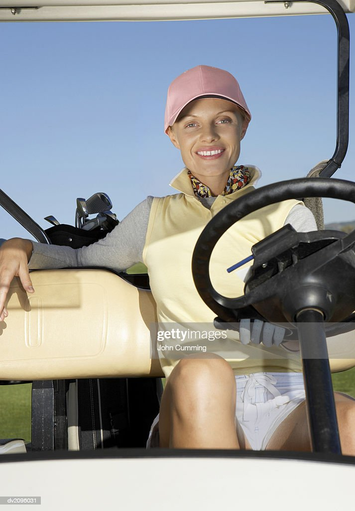 Woman Sitting in a Golf Buggy : Stock Photo