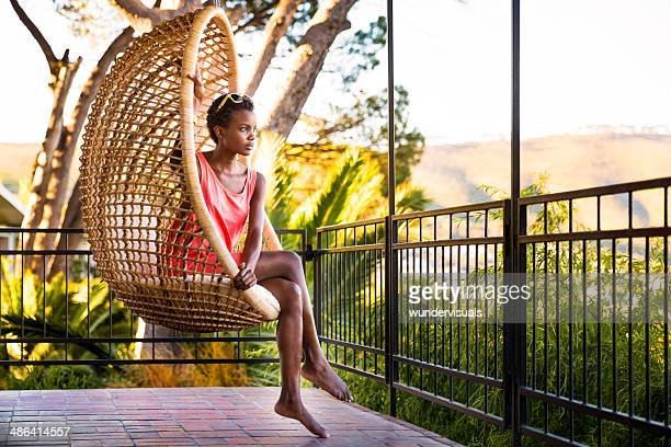 Woman sitting in a hanging chair