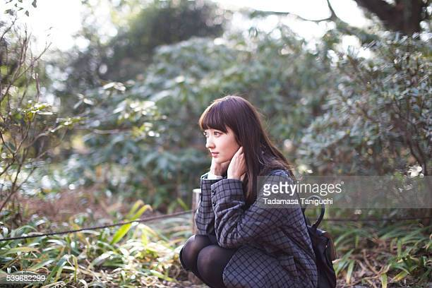 Woman sitting in a nature