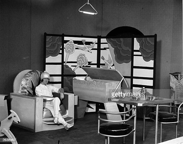 A woman sitting in a proposed nursery of the future at the Ideal Home exhibition Olympia London