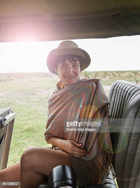 woman sitting in a safari car - camera point of view stock photos and pictures