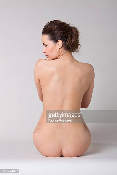 woman sitting in a spa - bare bottom women stock photos and pictures