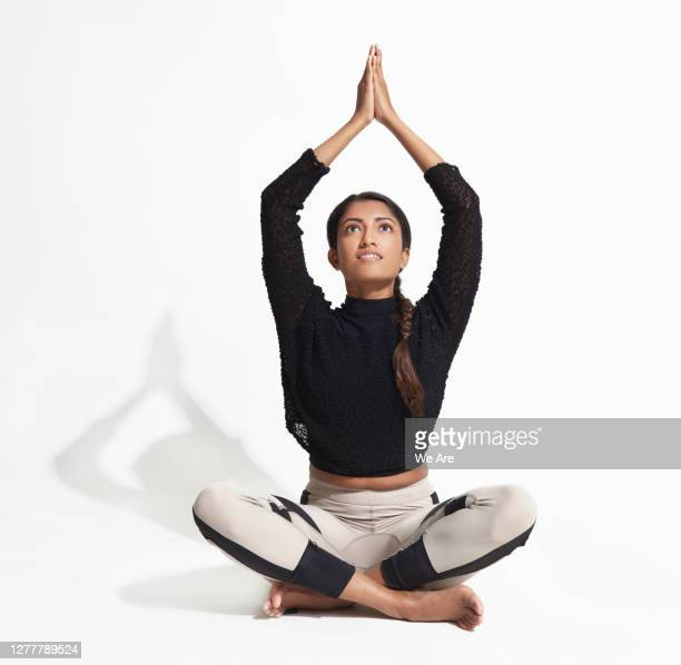 woman sitting in a yoga pose - stretching stock pictures, royalty-free photos & images